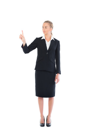 Young blonde business woman pointing on white background photo