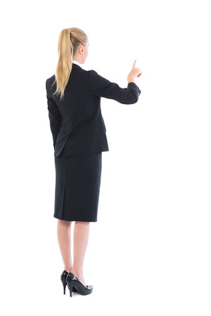 Young blonde businesswoman pointing on white background photo
