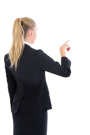 Blonde businesswoman pointing on white background photo