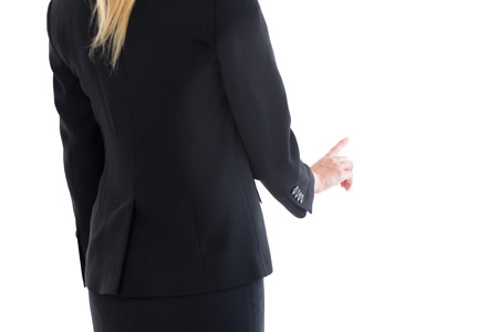 Mid section of blonde businesswoman pointing on white background photo