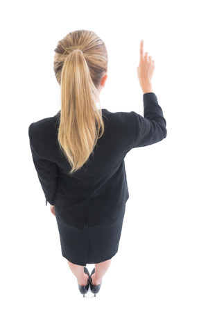 High angle rear view of blonde business woman pointing on white background photo