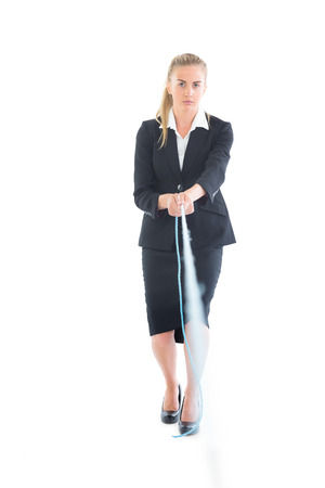 Serious young businesswoman using a hose looking at camera photo