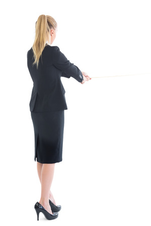Rear view of standing business woman pulling a rope on white background photo