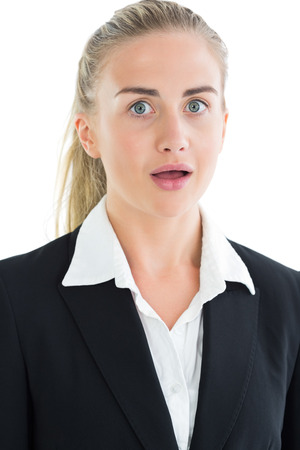 Portrait of astonished ponytailed young businesswoman on white background photo