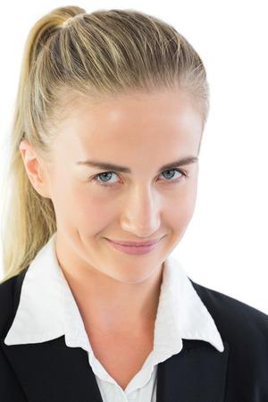 impish: Portrait of impish ponytailed businesswoman on white background