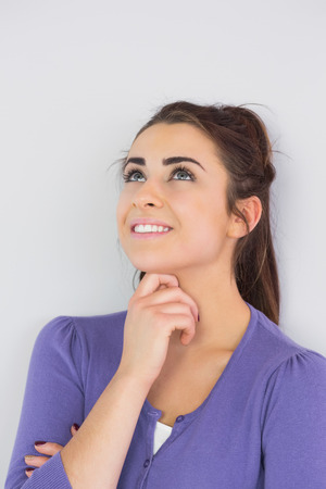 Handsome thoughtful woman wearing a purple cardigan Stock Photo
