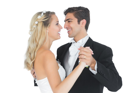 Sweet married couple dancing viennese waltz smiling at each other  photo
