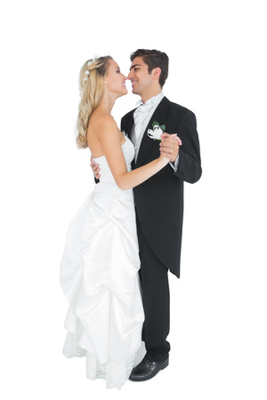 Happy married couple dancing viennese waltz on white background photo