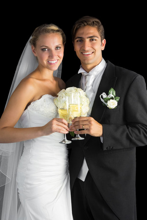Content married couple posing holding champagne glasses smiling at camera photo