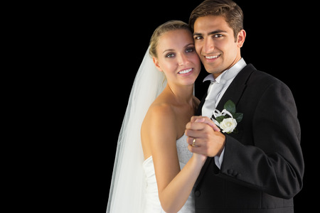 Smiling married couple dancing viennese waltz smiling at camera photo