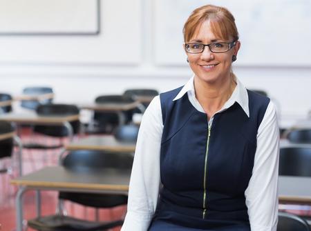 teacher in class: Portrait of a smiling female teacher in the class room