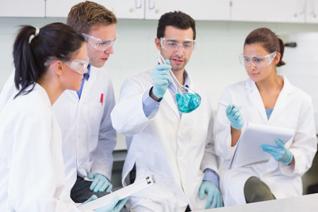 Group of scientists working on an experiment at the laboratory photo
