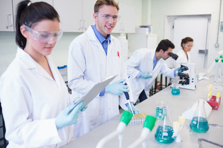 Group of researchers carrying out experiments in the laboratory photo
