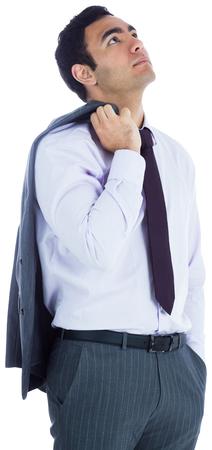 unsmiling: Unsmiling businessman standing Stock Photo