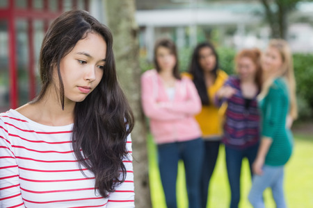 Female student being bullied by other group of students photo