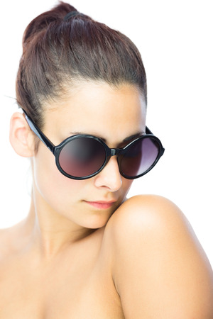 Pretty woman wearing gigantic round sunglasses on white background photo