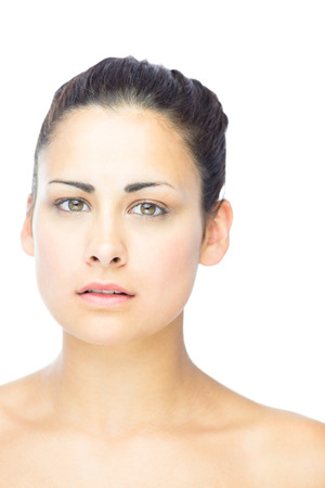 forlorn: Front view of lovely woman looking at camera on white background Stock Photo