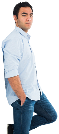 knees bent: Unsmiling casual man standing Stock Photo