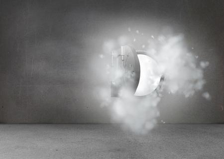 Open safe in dust cloud on grey wall photo