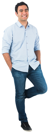 knees bent: Smiling casual man standing
