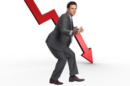 downwards: Businessman standing with arms out against red arrow pointing down Stock Photo