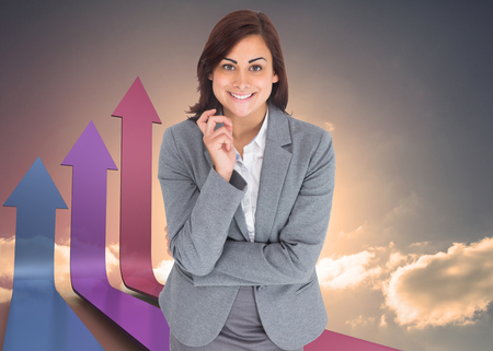 Smiling thoughtful businesswoman against colourful arrows pointing up against sky Stock Photo - 26777237