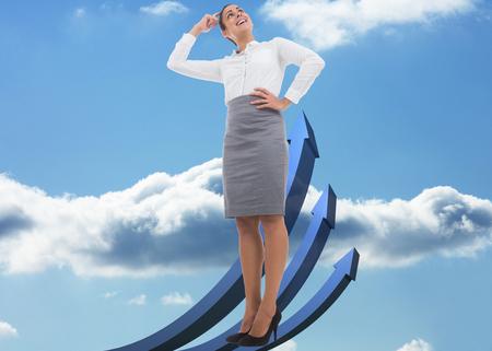flechas curvas: Sonriente mujer de negocios pensativa contra flechas curvas azules apuntando hacia arriba contra el cielo Foto de archivo