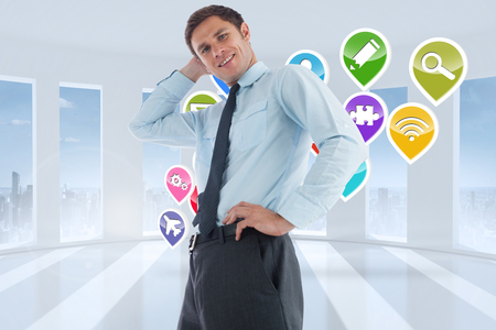 Thinking businessman with hand on head against application icons in white room photo