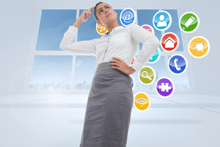 light brown hair: Worried businesswoman against application icons in white room
