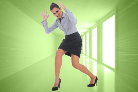 Furious businesswoman gesturing against bright green room with windows photo