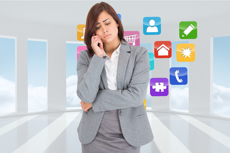 woman looking down: Thinking upset businesswoman against digitally generated room with bordered up window Stock Photo