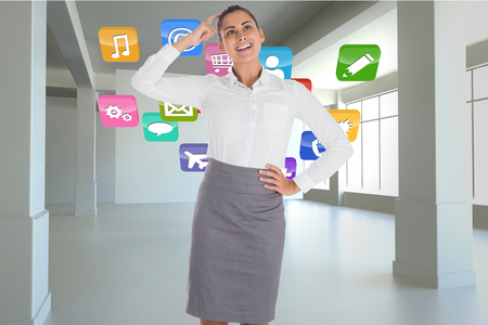 scratching head: Smiling thoughtful businesswoman against application icons in white room