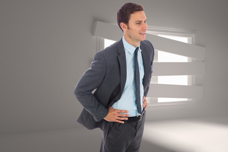 bordered: Cheerful businessman standing with hand on hip against digitally generated room with bordered up window