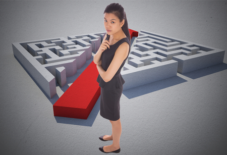 cutting through: Thoughtful businesswoman against red arrow cutting through puzzle