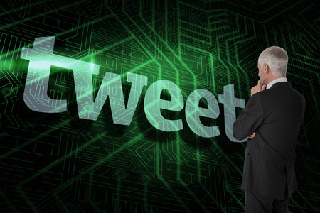 The word tweet and thoughtful businessman standing back to camera against green and black circuit board Stock Photo - 26796389