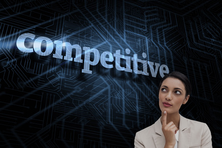 The word competitive and smiling businesswoman thinking against futuristic black and blue background photo