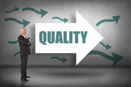 The word quality and happy businessman looking away against arrows pointing photo