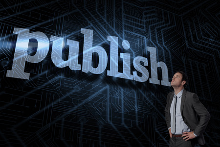 The word publish and serious businessman with hands on hips against futuristic black and blue background Stock Photo