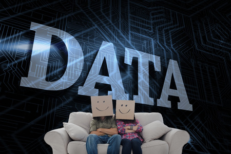 The word data and silly employees with arms folded wearing boxes on their heads against futuristic black and blue background photo