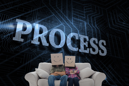 The word process and silly employees with arms folded wearing boxes on their heads against futuristic black and blue background photo