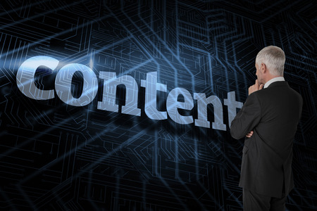The word content and thoughtful businessman standing back to camera against futuristic black and blue background photo