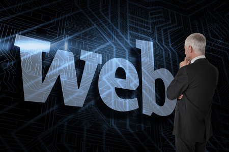 The word web and thoughtful businessman standing back to camera against futuristic black and blue background photo