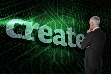 The word create and thoughtful businessman standing back to camera against green and black circuit board photo