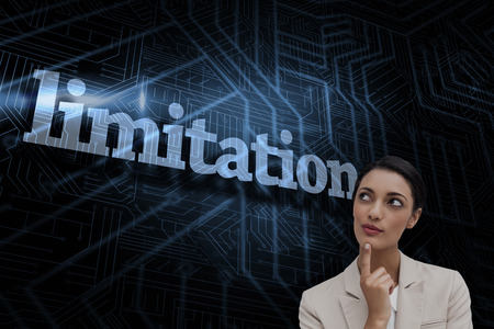 limitations: The word limitations and smiling businesswoman thinking against futuristic black and blue background