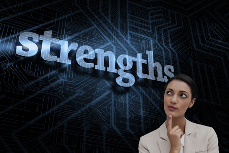 The word strengths and smiling businesswoman thinking against futuristic black and blue background Stock Photo