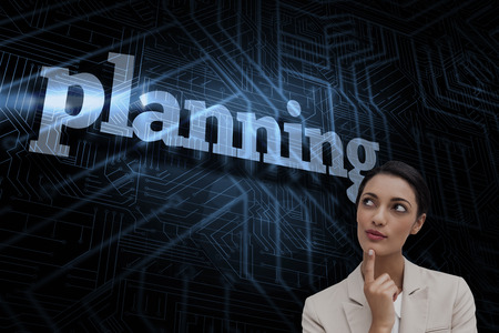The word planning and smiling businesswoman thinking against futuristic black and blue background photo