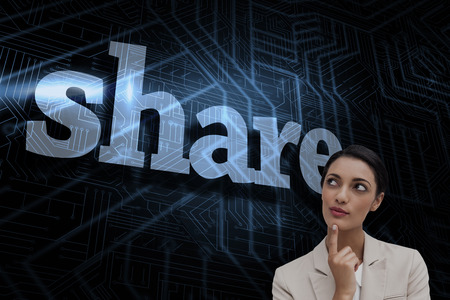 The word share and smiling businesswoman thinking against futuristic black and blue background photo