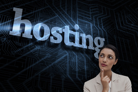 The word hosting and smiling businesswoman thinking against futuristic black and blue background photo