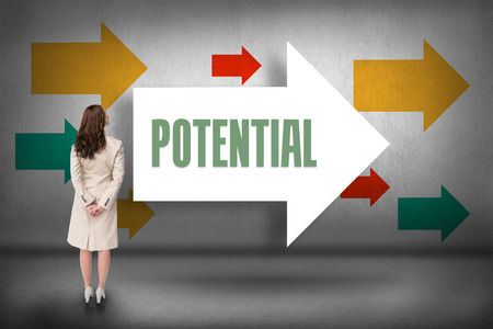 The word potential and rear view of businesswoman against arrows pointing photo
