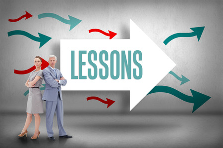 The word lessons and serious businessman standing back to back with a woman  against arrows pointing photo